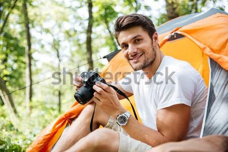Feliz moço turista olhando binóculo floresta Foto stock © deandrobot