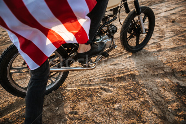 Cropped image of men leg starting motorcycle Stock photo © deandrobot