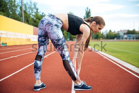 Cropped image of a fitness woman holding water bottle Stock photo © deandrobot