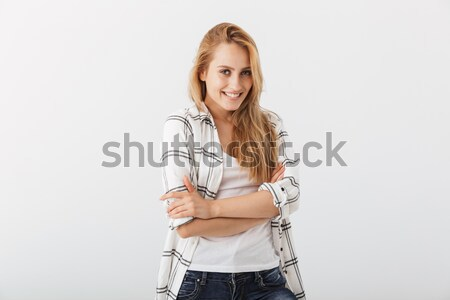 Sensual young woman in casual clothes standing Stock photo © deandrobot