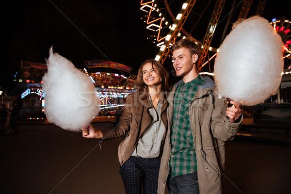 привлекательный пару парк с аттракционами хлопка конфеты Сток-фото © deandrobot