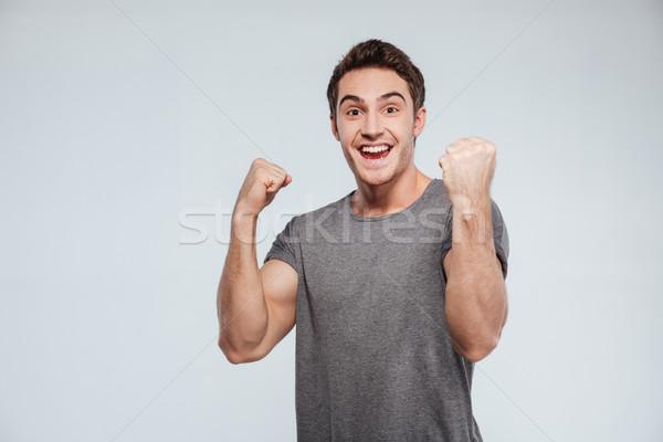Férfi ünnepel siker kettő levegő portré Stock fotó © deandrobot