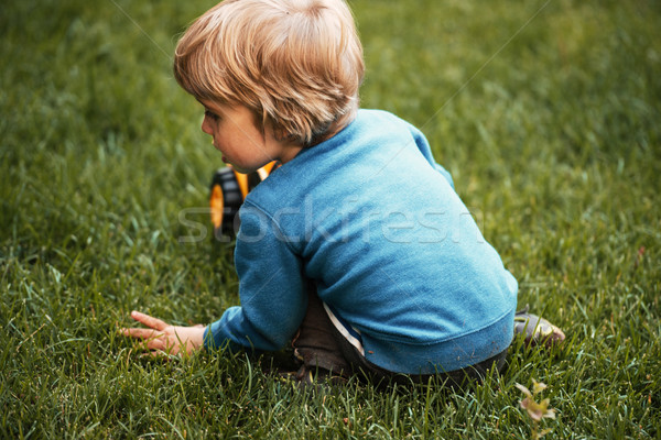 Back view of boy with machine Stock photo © deandrobot