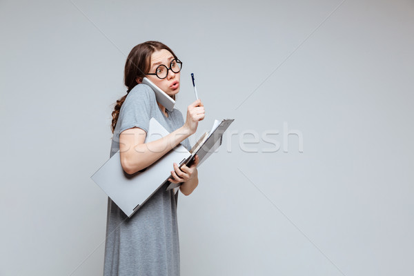 Young female nerd talking on phone Stock photo © deandrobot