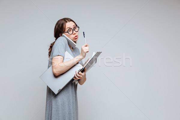 Fiatal női stréber beszél telefon lány Stock fotó © deandrobot