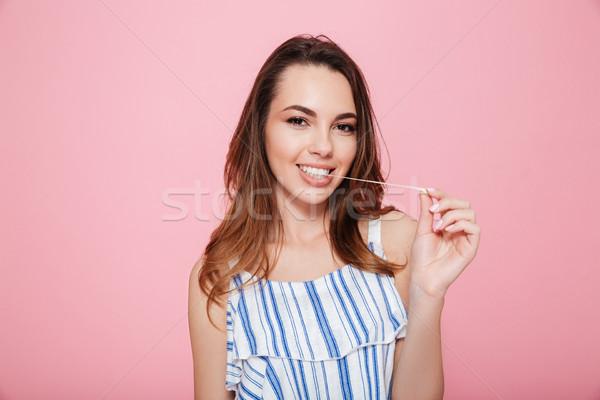 Boldog fiatal nő áll rág buborék íny Stock fotó © deandrobot