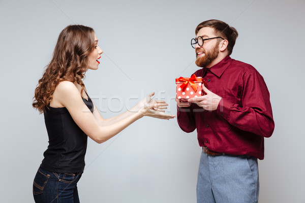 Male nerd presents the gift for Woman Stock photo © deandrobot
