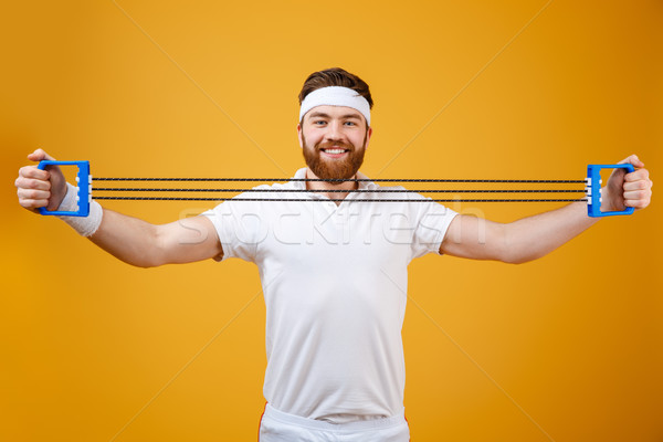 Sportsman make sport exercises with sport ecquipment Stock photo © deandrobot
