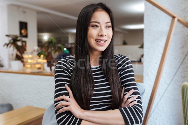 Nevet ázsiai nő karok büfé pulóver Stock fotó © deandrobot