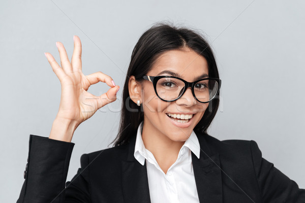 Woman in eyeglasses showing okay gesture Stock photo © deandrobot
