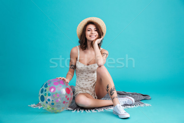 Portrait of a excited summer girl sitting on a blanket Stock photo © deandrobot