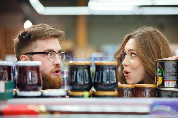 Couple regarder autre Mall heureux homme Photo stock © deandrobot