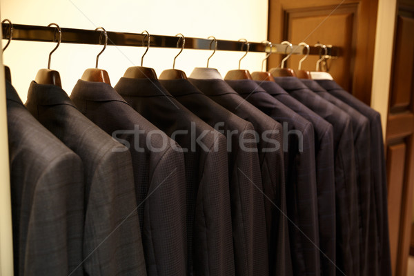 Photo of rack with suits Stock photo © deandrobot