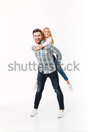 Cheerful couple making repairs in the apartment Stock photo © deandrobot