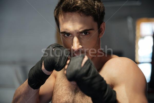 Joven boxeador mirando cámara manos retrato Foto stock © deandrobot