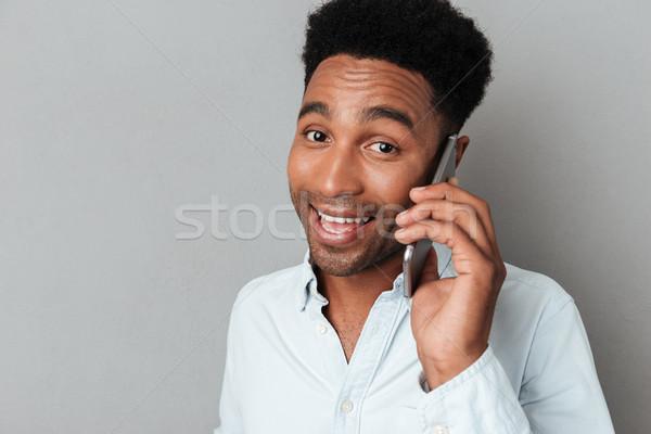 Porträt glücklich lächelnd african Mann Stock foto © deandrobot