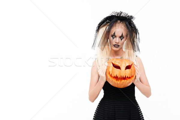 Scary blonde woman dressed in black widow costume Stock photo © deandrobot