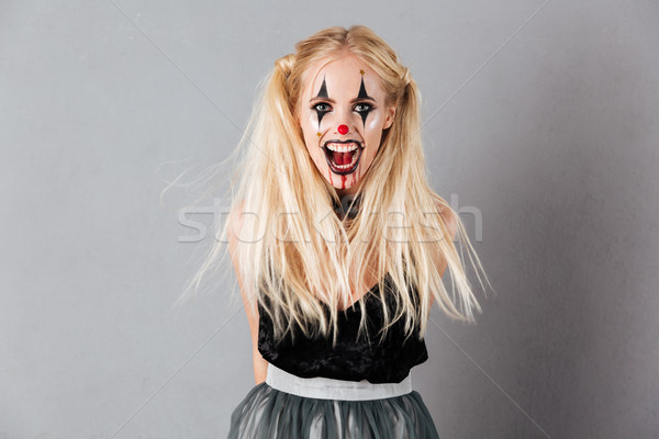 Frightening screaming blonde woman in halloween make up Stock photo © deandrobot