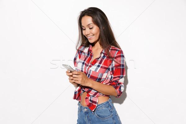 Közelkép fotó fiatal mosolyog barna hajú lány Stock fotó © deandrobot