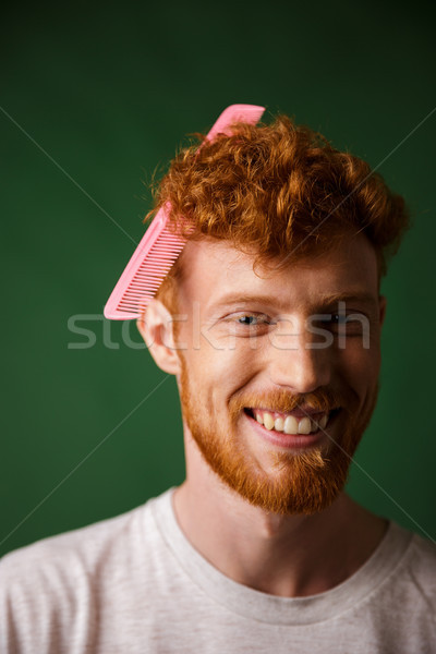 Close-up portrait of laughs young readhead man with pink hairbru Stock photo © deandrobot