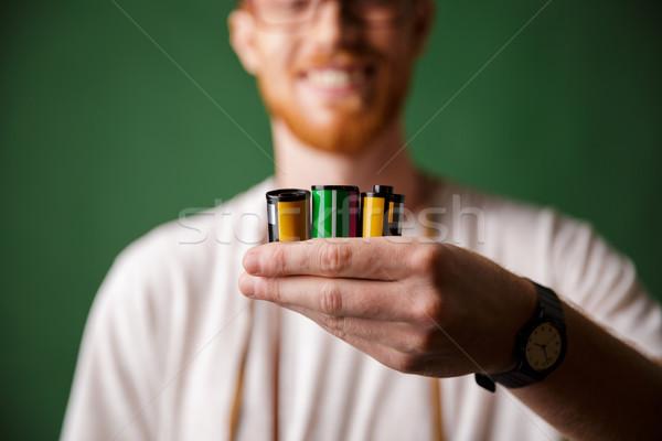 Cropped photo of readhead bearded photographer, holding camera r Stock photo © deandrobot