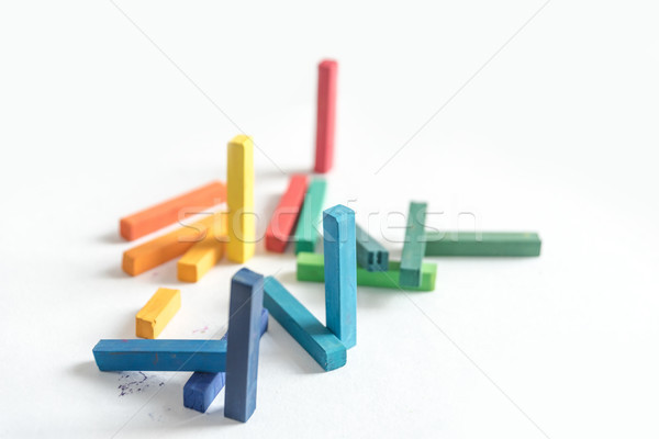 Group colored pastel chalks in a chaotic manner Stock photo © deandrobot
