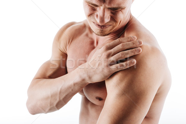Cropped image of sportsman have a painful feelings in body. Stock photo © deandrobot