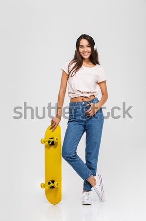Portrait of a joyful young girl sitting record player Stock photo © deandrobot