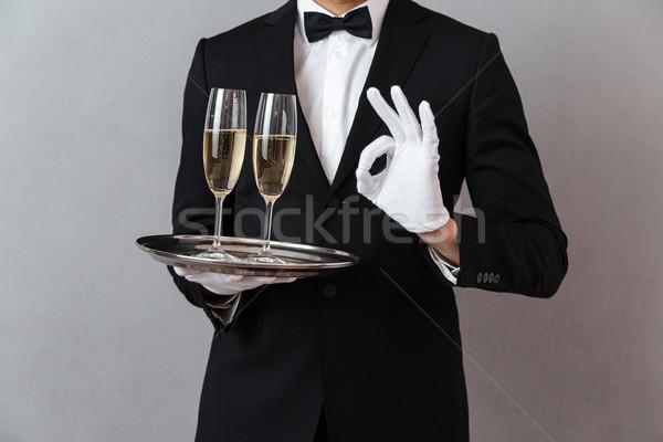 Imagen jóvenes camarero pie aislado gris Foto stock © deandrobot