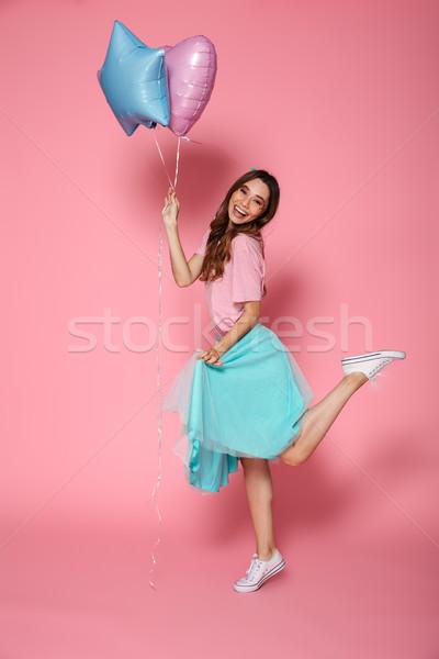 Full length portrait of a happy pretty girl Stock photo © deandrobot