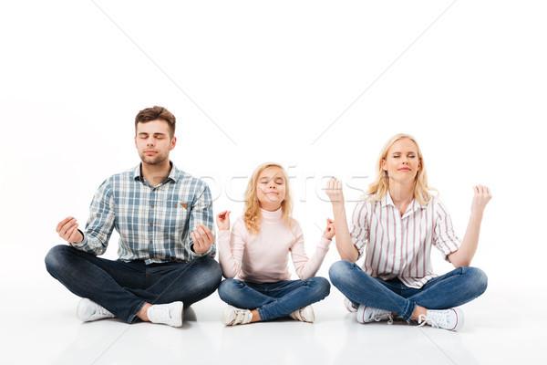 Stock photo: Portrait of a happy family meditating