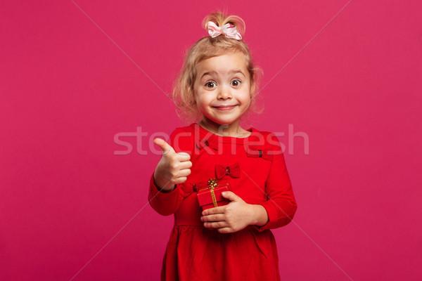 Mutlu genç kız kırmızı elbise Stok fotoğraf © deandrobot