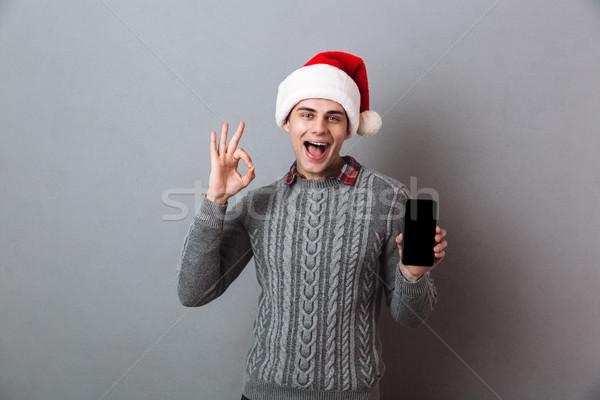 Fiatal boldog érzelmes férfi visel karácsony Stock fotó © deandrobot