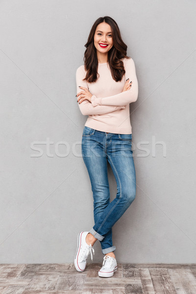 Full-length shot of caucasian smiling woman with red lips makeup Stock photo © deandrobot