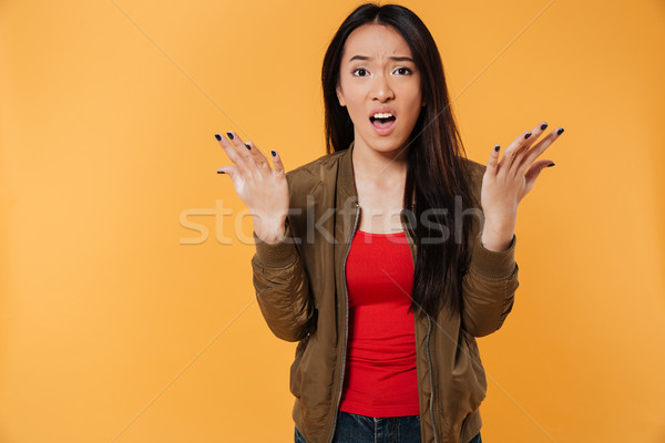 Portrait of a frustrated confused asian girl Stock photo © deandrobot