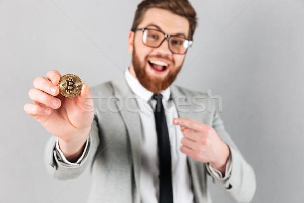Close up portrait of a happy businessman Stock photo © deandrobot
