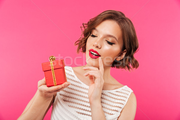 Close up portrait of an attractive girl dressed in dress Stock photo © deandrobot