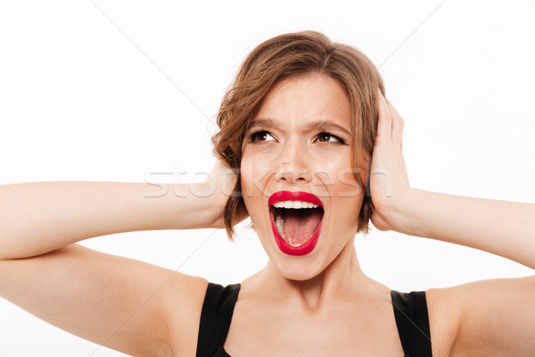 Close up portrait of a furious girl screaming Stock photo © deandrobot