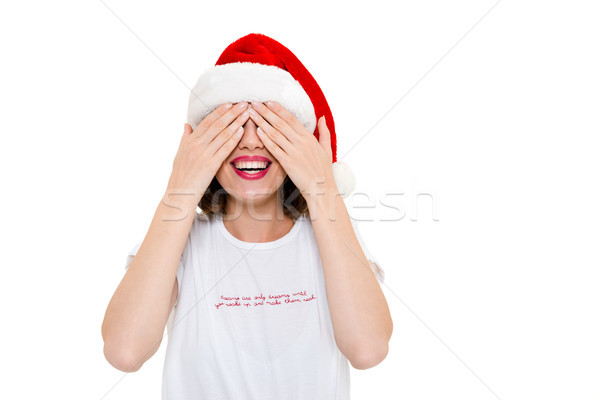 Pretty caucasian woman wearing christmas hat covering eyes with hands. Stock photo © deandrobot