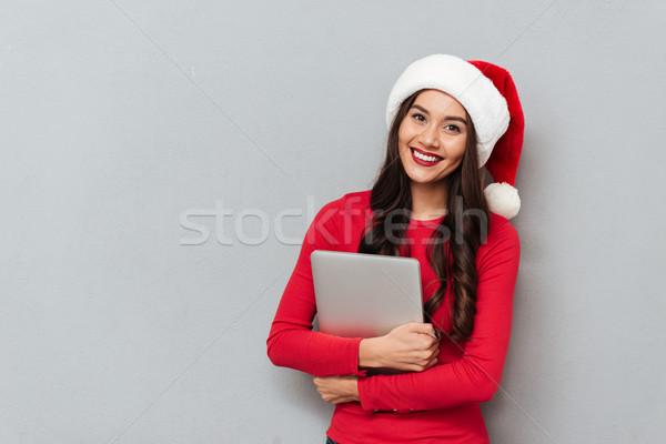 улыбаясь брюнетка женщину красный блузка Рождества Сток-фото © deandrobot