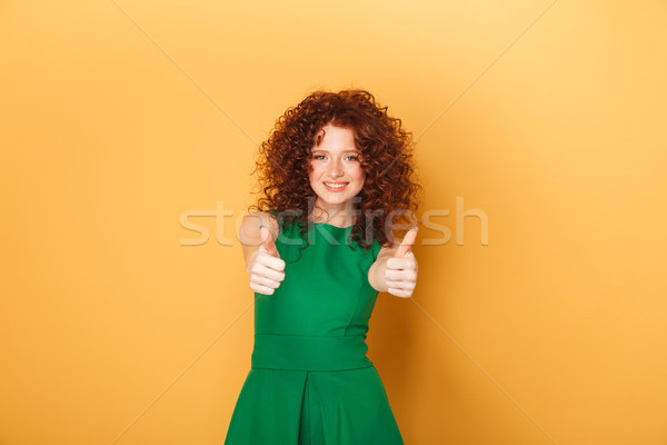 Portrait of a smiling curly redhead woman Stock photo © deandrobot