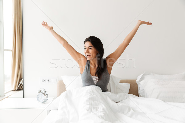 Photo of lovely beautiful woman waking up and rejoicing morning, Stock photo © deandrobot