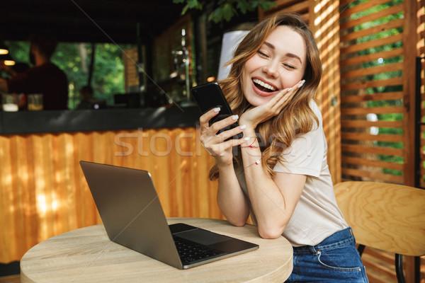 肖像 満足した 若い女の子 携帯 携帯電話 ストックフォト © deandrobot