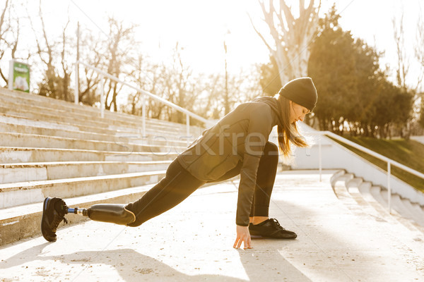 Image of disabled sporty woman in sportswear, doing sports and s Stock photo © deandrobot