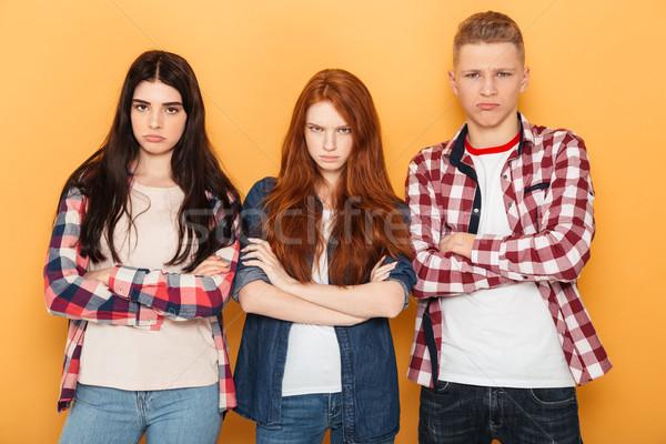 Groep ontdaan school vrienden naar camera Stockfoto © deandrobot