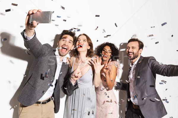 Csoport boldog jólöltözött emberek elvesz konfetti Stock fotó © deandrobot