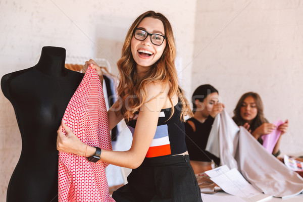 Happy young woman clothes designer at the atelier Stock photo © deandrobot