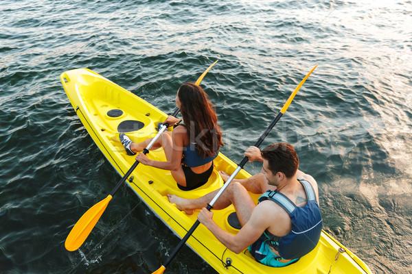 Hátsó nézet fiatal pér kajakozás tó együtt nő Stock fotó © deandrobot