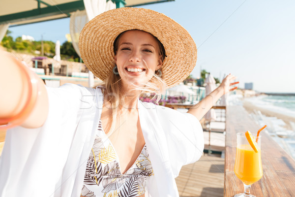 Excited young girl in summer hat and swimwear Stock photo © deandrobot