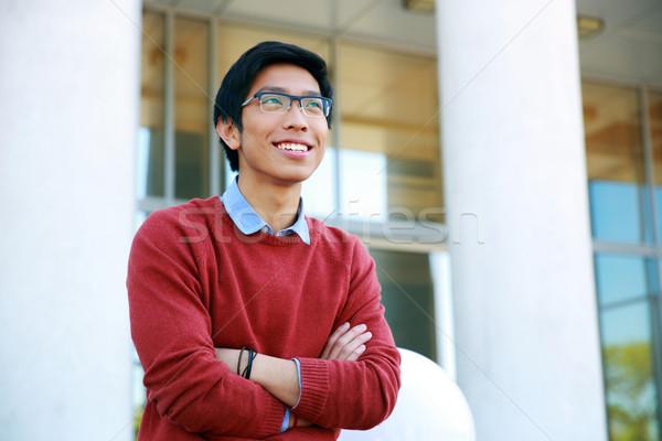 Portrait jeunes heureux asian homme bras Photo stock © deandrobot